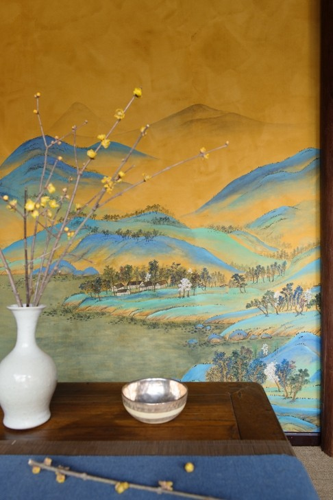 A rendition of Wang Ximeng's A Thousand Li of Rivers and Mountains from De Gournay's Emperor Collection of wallpaper.